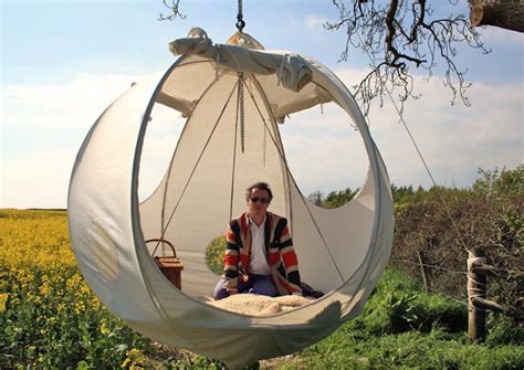Roomoon a spherical luxury hanging tent with a steel frame and pine wood floor