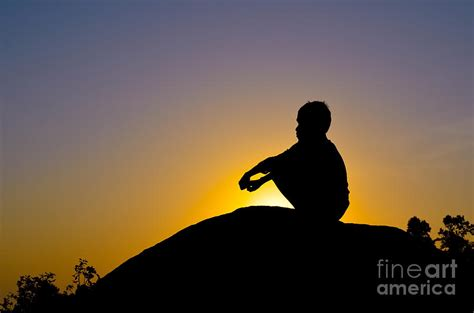 World Shower Curtain Silhouette Of Boy Sitting On Rock Photograph By Image World