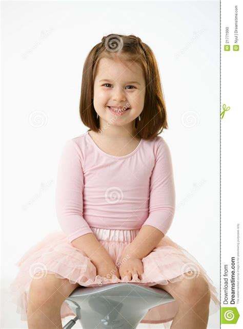 little girl on chair little girl sitting on chair stock photo image 21771990