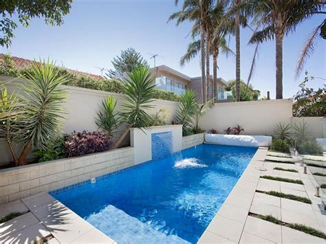 endless pool design using bluestone with pool fence