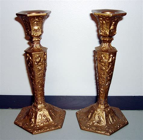 vintage fully ornate candle holders by wb mfg co from