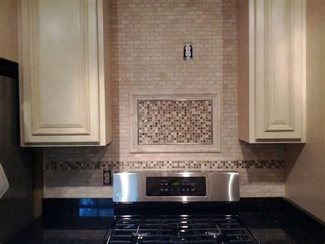 timeless backsplash kitchen renovation featuring our antique white cabinets