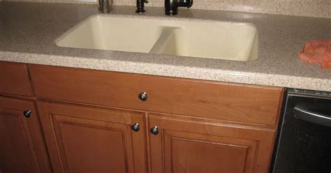 replacing a corian sink with a farmhouse sink hometalk