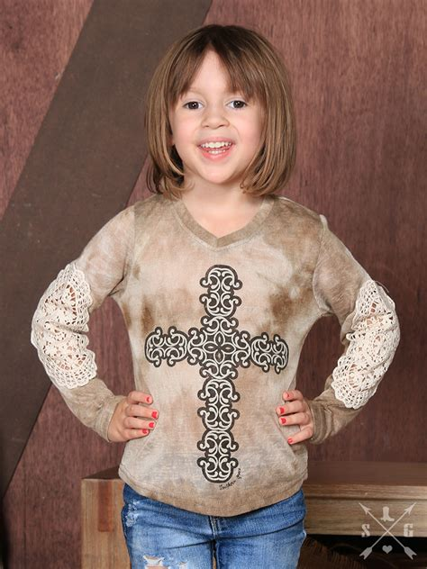 Kid Grace Denim s cross sleeve with lace accent on sleeve