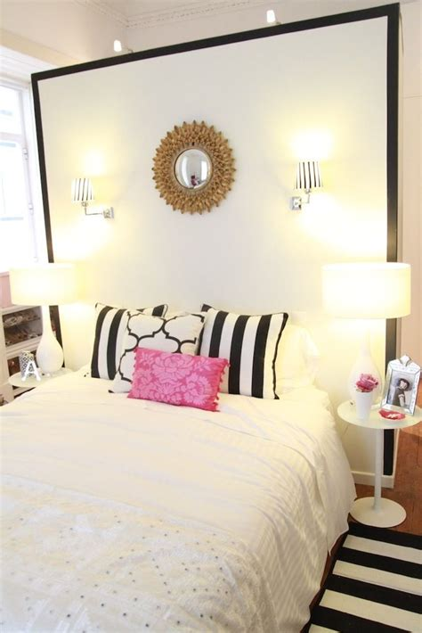 black white pink bedroom gold sunburst mirror