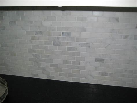 white marble tile backsplash subway tile