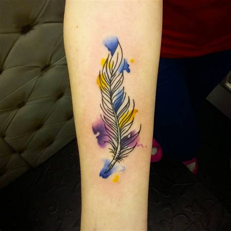 feather tattoo near eye 30 fabulous feather tattoos for only the most discerning
