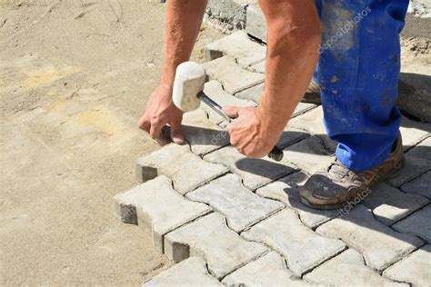Dalle Exterieur Pas Cher 3333 by Worker Laying Interlocking Pavers Stock Photo