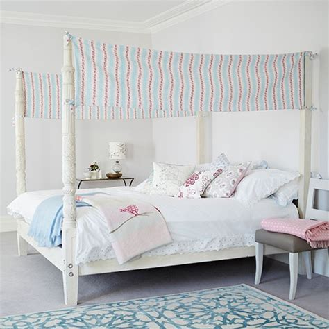 four poster bed with pretty fabric panels white bedroom