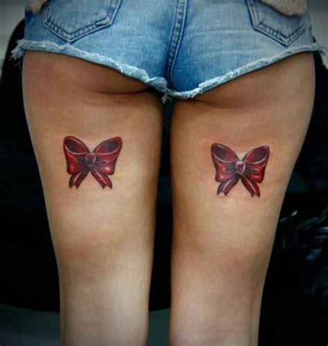 schleife oberschenkel tattoo von 2nd face
