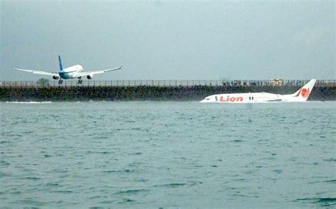 emirates denpasar plane misses runway and lands in sea emirates 24 7