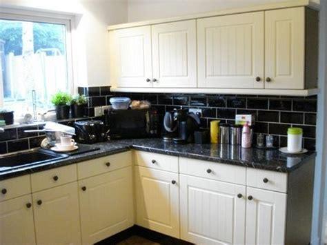 cream and black kitchen ideas cream kitchen doors black worktop