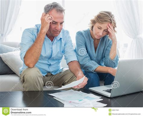 pay rooms to go bill worried paying their bills with laptop stock image image 32517551