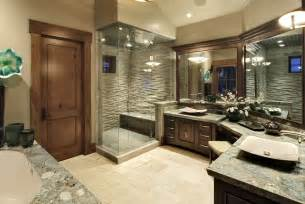 Bathrooms By Design the lavish master bathroom features a wraparound double vanity with