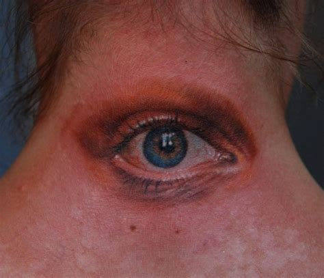 eyeball tattoo on back of head realistic eye tattoo on neck tattooimages biz