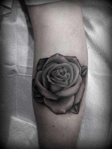 realistic black rose tattoo black and grey do purple shades with grey leaves