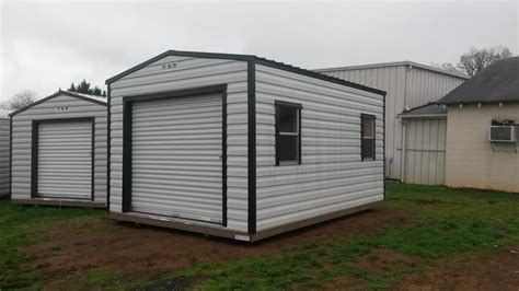 Storage Shed Garage Door by Repo Storage Buildings For Sale In Nc Hometown Sheds