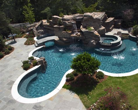 huge backyard pools elaborate swimming pool featuring large grotto waterfall