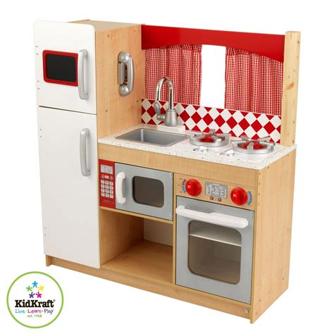 wood designs play kitchen wood vs quot electronic quot plastic play kitchen babycenter