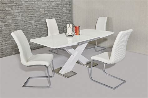 extending white gloss dining table  white chairs