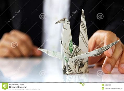 Origami Holding - holding origami paper cranes stock photography