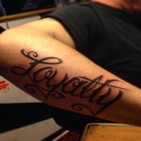 loyalty tattoo on forearm script loyalty electric elephant
