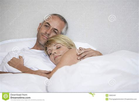 romantic couple relaxing in bed stock image image 33832461