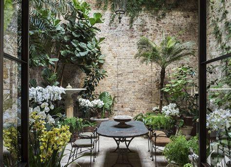 trending  gardenista april showers small courtyard