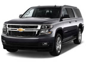 comparison chevrolet suburban suv 2016 vs cadillac
