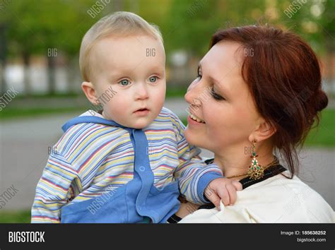 backyard leisure holdings happy mother holding her adorable image photo bigstock