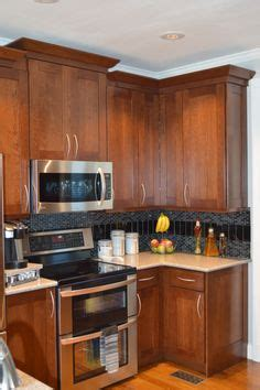 Hayward Kitchen Cabinets Kraftmaid Maple Cinnamon Cabinets With Black Galaxy Granite Jeffery Court Pencil
