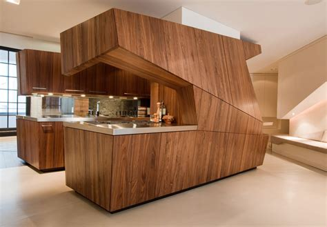 modern loft with a freestanding centralized wood veneer kitchen digsdigs