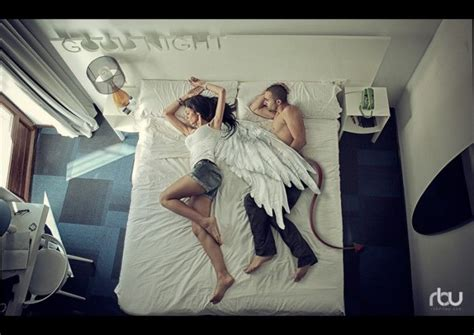 in bed with the devil girl with angel wings man with devil s tale sleeping in a bed inspire conceptual