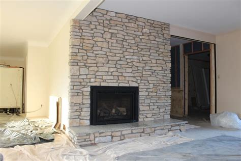 stacked stone veneer over brick fireplace how to cover a