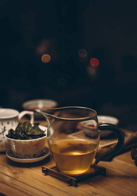 gold kettle pouring hot water  cup  tea  stock photo