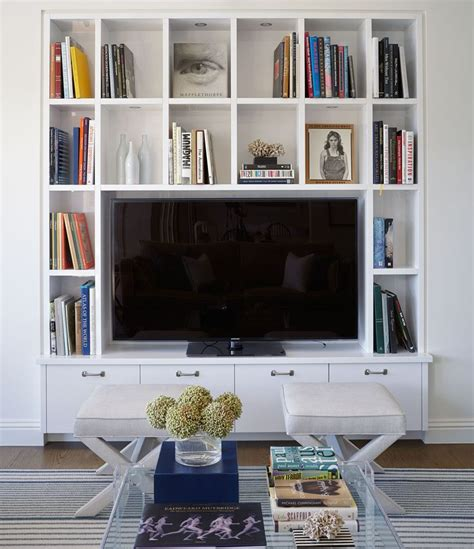 bookshelves around tv 1000 ideas about living room tv on tvs tv