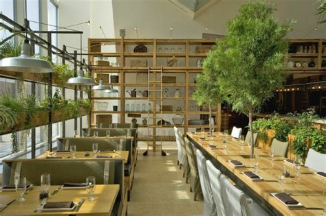 jg domestic americana restaurant serves   living wall