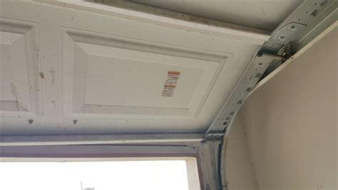 garage door replacement track garage door track replacement 3 essential tips for