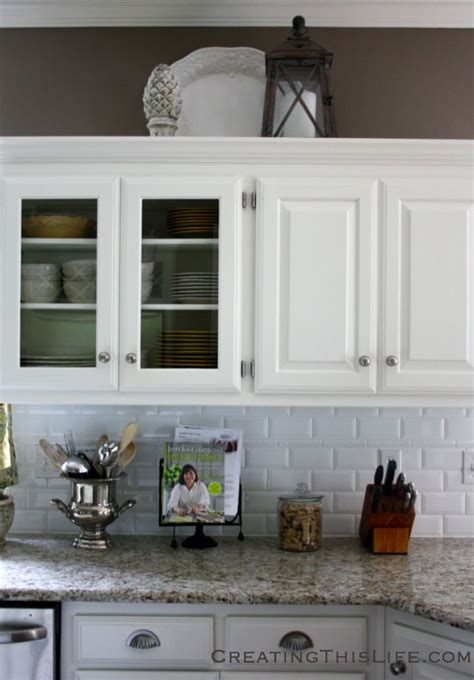 what to do with the space above your kitchen cabinets that space above the cabinets creating this
