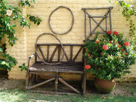 garden with bench file wooden garden bench and trellises jpg