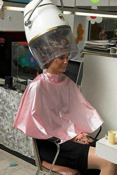 under the dryer with rollers on salon cape a brief history of beauty pinterest