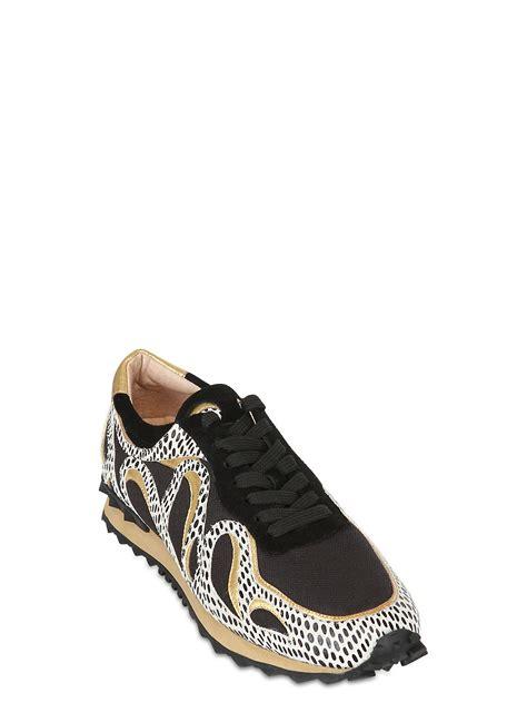 lola sneakers lola 40mm elaphe print leather sneakers in black for