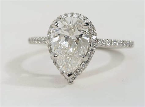 shaped wedding rings with diamonds pear shaped halo engagement ring in platinum