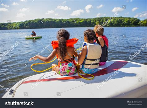 family boating vacations family tubing boat on inland lake stock photo 400863919