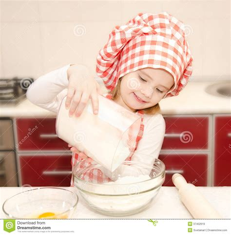 Cutlery Set smiling little girl with chef hat put flour for baking