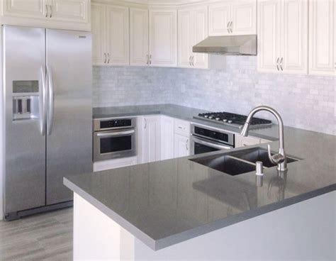 white kitchen cabinets with grey countertops www