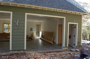 French Door Shutters - trim wraps up concrete starts up modern craftsman style home