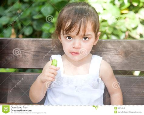 girl with cucumber wild cucumber eater stock photos image 34754943