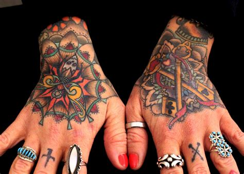 badass hand tattoos paradise gathering tattoos traditional