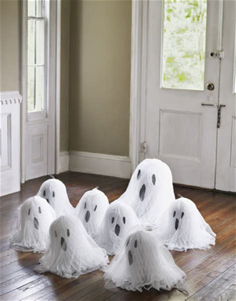 easy diy halloween home decor ideas with ghosts bats and honeycomb paper halloween crafts